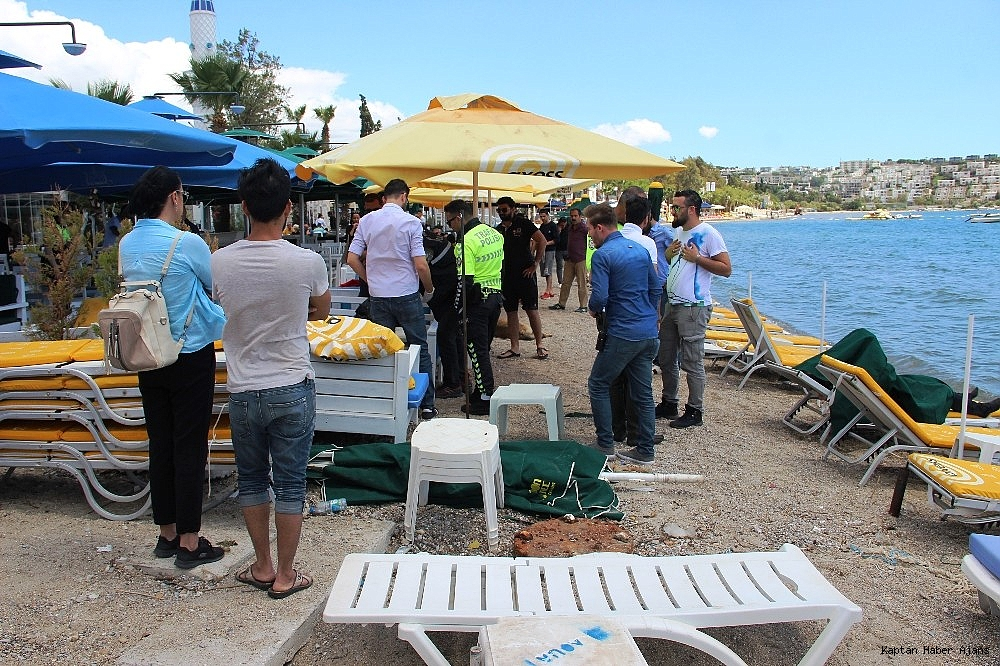 2019/05/sahilde-denize-giren-turistler-sok-oldu-20190502AW69-10.jpg
