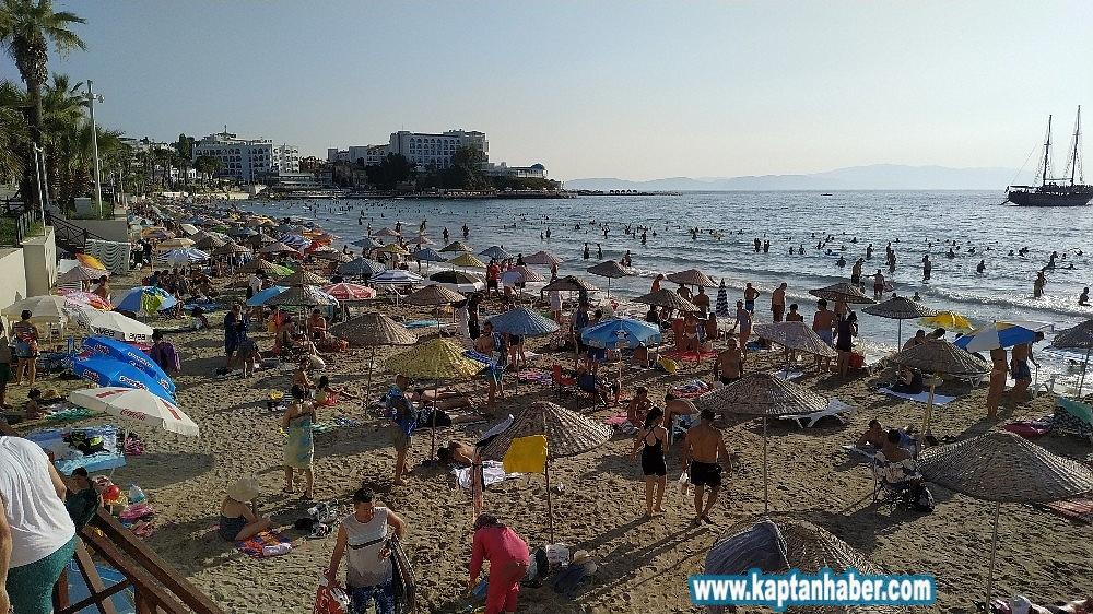 2019/08/kusadasinda-sicaktan-bunalan-plaja-kostu-20190804AW77-4.jpg