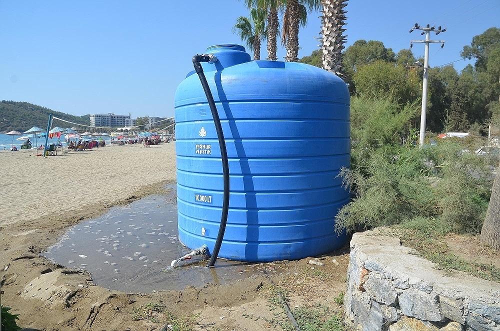 2020/08/kusadasi-kustur-plajinda-belediyeye-ait-su-deposu-ve-uniteler-tahrip-edildi-20200812AW08-1.jpg