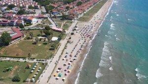 Kuşadası Belediyesi zabıtası Kuşadası Körfezindeki sahilleri drone ile denetliyor