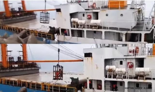 Sürüklenerek batan gemiden sepetli vinçle tahliye operasyonu! (Video)